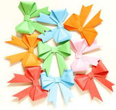Colored paper origami bows for holiday cards — Stock Photo