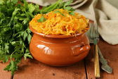 Braised cabbage with carrots and tomato sauce with capers — Stock Photo