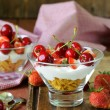 Dairy yogurt dessert with cherries and strawberries — Stock Photo #47384119