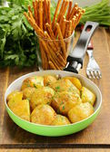 Tasty baked potatoes with herbs in the pan — Stock Photo