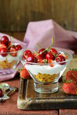 Dairy yogurt dessert with cherries and strawberries — Stock Photo
