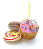 Birthday cupcake with a candle and holiday desserts — Stock Photo