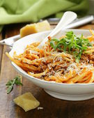 Traditional pasta with tomato sauce spaghetti bolognese with parmesan — Stock Photo