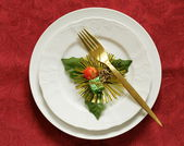 Christmas table setting (white plates on a red background) — Stock Photo