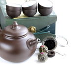Set for a traditional tea drinking (kettle, cups and various tea) — Stock Photo