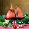 Pears cooked in wine with spices (cinnamon and anise) Christmas table setting — Zdjęcie stockowe