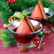 Pears cooked in wine with spices (cinnamon and anise) Christmas table setting — Foto de Stock   #48953203