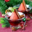 Pears cooked in wine with spices (cinnamon and anise) Christmas table setting — Foto Stock #48953203