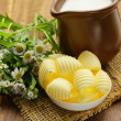 Fresh yellow dairy butter in a white bowl — Stock Photo #49337969
