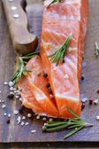 Salty delicacy red salmon fish on wooden board — Stock Photo