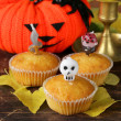 Traditional halloween treats cupcakes with funny candles — Stock Photo #49543279