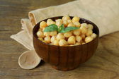 Fresh roasted chickpeas with basil leaves — Stock Photo