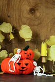 Halloween still life - pumpkin with  yellow leaves on the wooden background — Стоковое фото