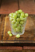 Fresh ripe green gooseberries on wooden table — Stock Photo