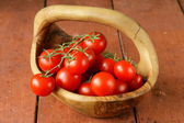 Fresh ripe organic tomatoes on a wooden table — Стоковое фото