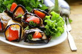 Vegetable saute fried eggplant rolls with tomatoes — Stock Photo