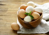 Natural organic eggs in a wooden bowl — Stock Photo