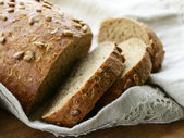 Loaf of rye bread with sunflower seeds — Stok fotoğraf