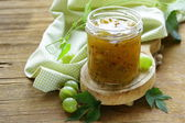 Green gooseberry jam on a wooden table — Stock Photo