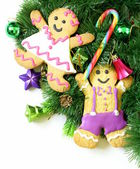 Traditional Christmas gingerbread man with festive decorations and Christmas tree — Stock Photo