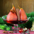 Pears cooked in wine with spices (cinnamon and anise) Christmas table setting — Stockfoto