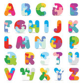 Vector alphabet written with puzzle — Vector de stock