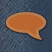 Leather speech bubble on jeans texture — Vetor de Stock