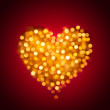 Shiny blurred gold heart — Stock Photo