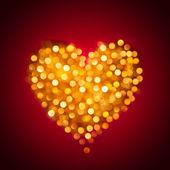 Coração de ouro brilhante turva — Fotografia Stock