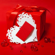 Cute red gift box with Valentines card — Stock Photo