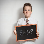Schoolboy has thought of the task decision — Stock Photo