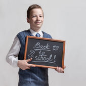 Schoolboy with chalkboard - back to school — Stock Photo