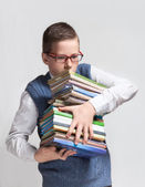 Schoolboy in glasses with books — Stock Photo