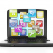 Stock Photo: Download applications from Internet. laptop and group of