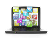 Download applications from the Internet. A laptop and a group of — Stock Photo