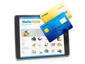 Tablet PC, payment for goods in the media store. Tablet computer — Stock Photo