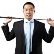 Stock Photo: Businessman holding the golf iron