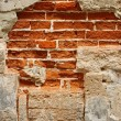 Old brick masonry with destroyed stucco — Stock Photo #14626221