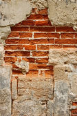 Old brick masonry with destroyed stucco — Stock Photo
