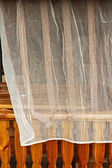 Curtains in wooden mezzanine — Stock Photo