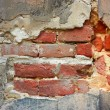 Old brick wall with destroyed stucco — Stock Photo #16324547