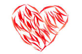 Heart from red petals over white — Stock Photo