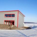 Frozen construction among winter field — Stock Photo