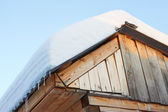 Roof of rustic wooden with snow — Stock Photo