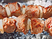 Meat roasted in chargrill — Stock Photo