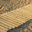 Wooden mat on a sandy beach — ストック写真