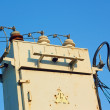Old transformer against blue sky — Stock Photo