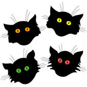 Four cat head black silhouettes — Stock Vector