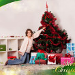 Kids with their christmas presents — Stock Photo #13981690