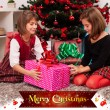 Kids with their christmas presents — Stock Photo #13980578